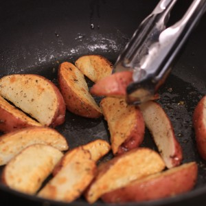 Red Wedge Potatoes Cooking in pan